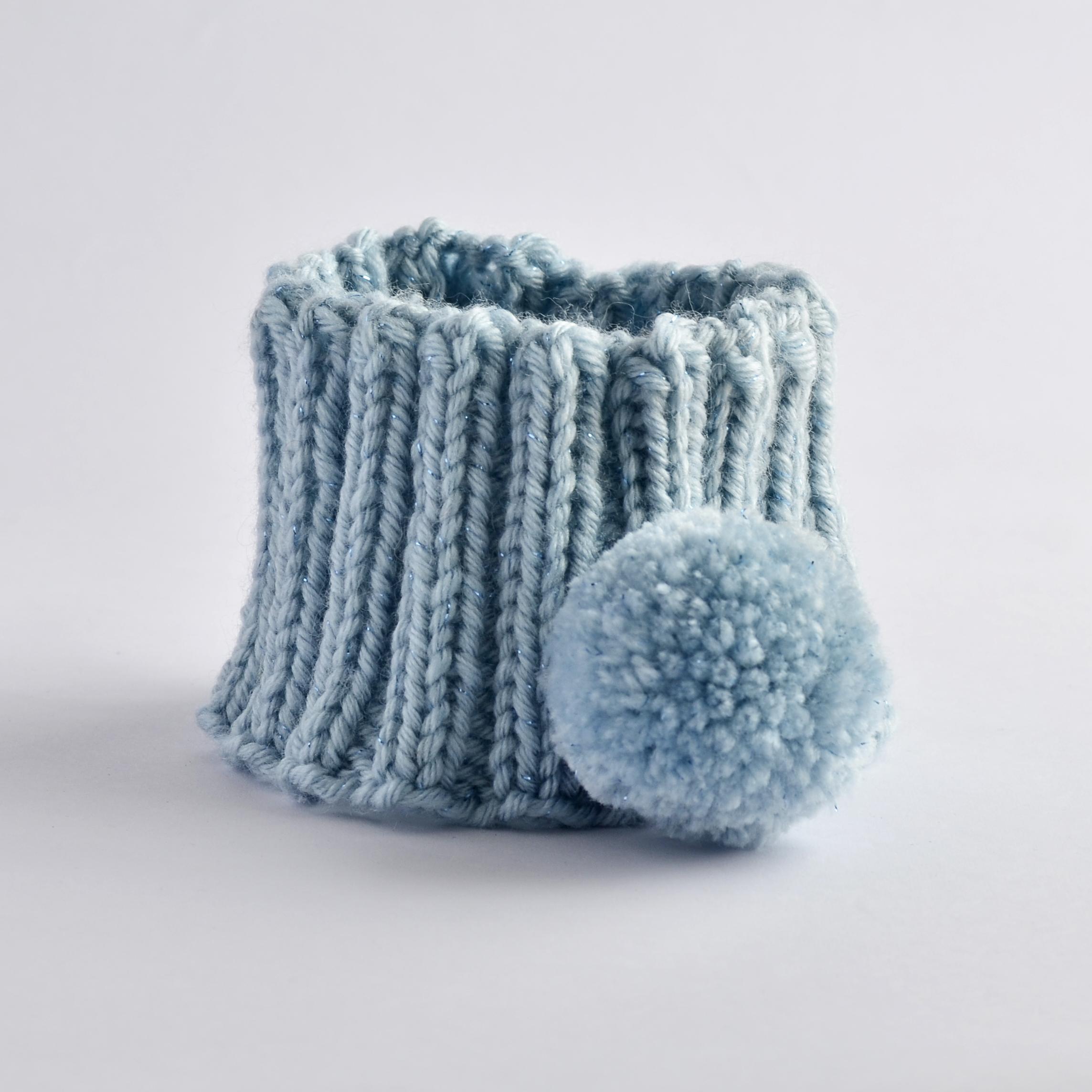 Stirnband mit Bommel hellblau
